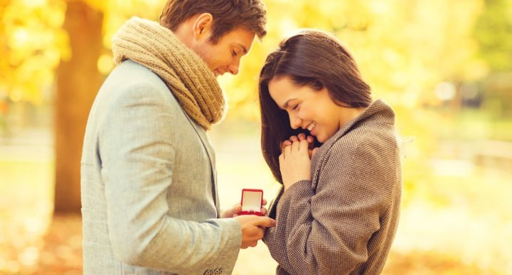 29244243 - holidays, love, couple, relationship and dating concept - romantic man proposing to a woman in the autumn park